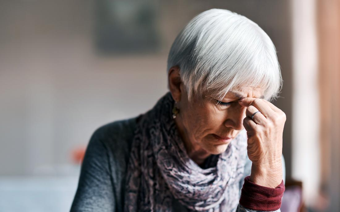 a woman experiencing a headache because of Metabolic acidosis